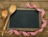 Writing board and spoon — Stock Photo