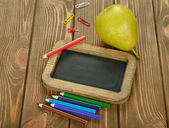 Writing board and pencils — Stock Photo