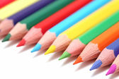 Line of colored pencils (isolated) — Stock Photo