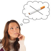 Girl dreaming to quit smoking — Stock Photo