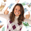 Successful girl on falling euros background — Stock Photo