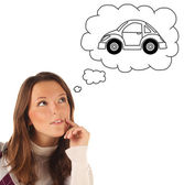 Girl dreaming about owning a car (isolated) — Stock Photo