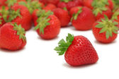 Scattered strawberry (isolated) — Stock Photo