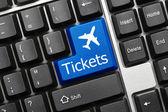 Conceptual keyboard - Tickets (blue key with aeroplane symbol) — Stock Photo
