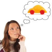 Girl dreaming about car (isolated) — Stock Photo