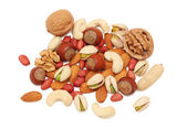 Pile from different kinds of nuts (isolated) — Stock Photo