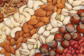 Different nuts lie strips — Stock Photo