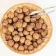 Walnuts in small basket — Stock Photo