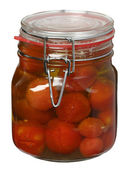 Tomato conserved in glass jars isolated on the white background — Stock Photo