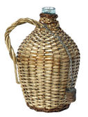Big bottle in wicker basket — Stock Photo