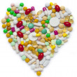 Heart of pills and capsules — Stock Photo