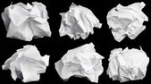 Crumbled up paper isolated on black background. — Stock Photo