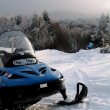 Snowmobile on beautiful winter mountain landscape — Stock Photo #41742105