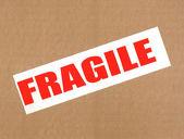 Fragile written on cardboard Brown — Stock Photo