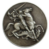 Metal medal depicting St George as a horse rider fighting a drak — Stock Photo