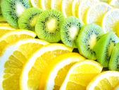 Assorted fruit - orange, lemon and kiwi — Stock Photo