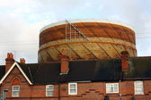 Gasometer and terraced House Rooftops — Stock Photo