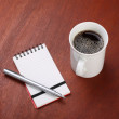 Cup of Black Coffee and Writing Pad — Stock Photo