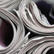 Постер, плакат: Rolled up Newspapers
