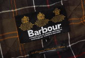 The Barbour Label and Tartan — Stock Photo