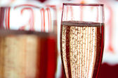 Background glasses with champagne with bubbles — Stock Photo