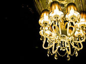 Mystical interior with chandelier lights and reflections — Stock Photo