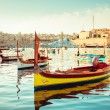 Stock Photo: Fort St Angelo Seafront and maltese boat LUZZU