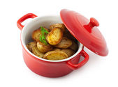 Roasted potatoes and herbs in the pan — Stock Photo