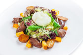 Warm salad with turkey liver and poached egg — Stock Photo