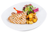 Roasted pork stake at the white plate — Stock Photo