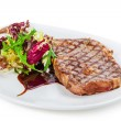 Delicious grilled steak ribeye with salad - Stock Photo