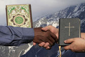 Gesture of peace. The Bible and the Koran. — Stock Photo