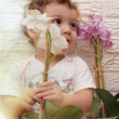 A boy with a flower — Stock Photo #12441011
