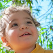 Curious boy in the park — Stock Photo #12441128