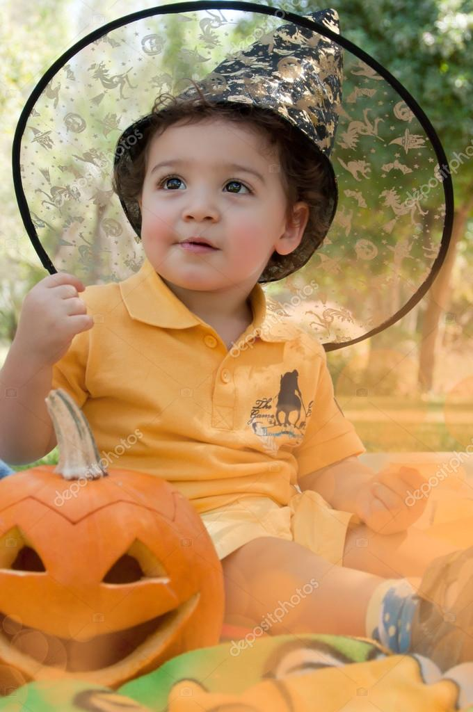 A small boy with pumpkin waiting for the party — Stock Photo #12441082
