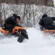 Stock Photo: Mriding ATV in snow