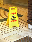 Wet floor — Stockfoto