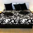 Modern double bed - Stock Photo