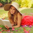 Young Woman Reading Book Outside - Stock Photo