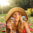 Royalty-Free Stock Photo: Beautiful Woman Blowing Bubbles