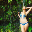 Stock Photo: Woman underwaterfall in Hawaii
