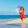 Beautiful Woman Walking on Tropical Beach — Stock Photo