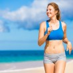 Beautiful Athletic Woman Running on the Beach — Stock Photo
