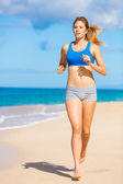 Beautiful Athletic Woman Running on the Beach — Stock Photo