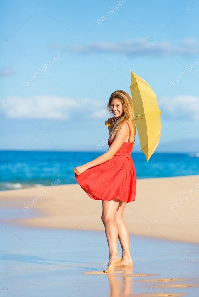Beautiful Young Woman Walking on Tropical Beach with Colorful Umbrella  Stock Photo #13844139