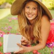 Young Woman Reading Book Outside — Stock Photo #13987557