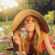 Beautiful Woman Blowing Bubbles - Stock Photo