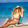 Beautiful Woman Relaxing on the Beach — Stock fotografie #13987616