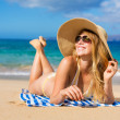 Beautiful Woman Relaxing on Tropical Beach — Stock Photo #13987651