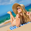 Beautiful Woman Relaxing on Tropical Beach — Stock Photo #13987658